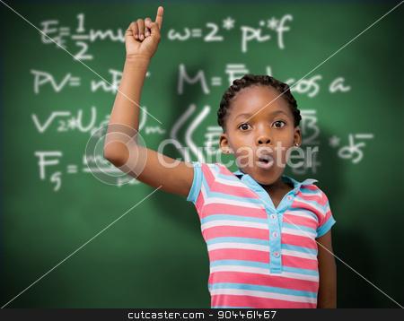 Composite image of portrait of cute schoolgirl with hand raised stock photo, Portrait of cute schoolgirl with hand raised against green chalkboard by Wavebreak Media