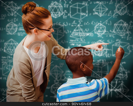 Composite image of happy pupil and teacher stock photo, Happy pupil and teacher against green chalkboard by Wavebreak Media