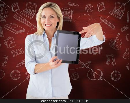 Composite image of mature student showing tablet pc stock photo, Mature student showing tablet pc against desk by Wavebreak Media
