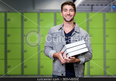 Composite image of student smiling at camera in library stock photo, Student smiling at camera in library against locker room by Wavebreak Media