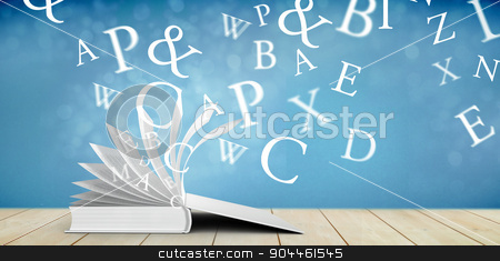 Composite image of letters stock photo, letters against light design shimmering on silver by Wavebreak Media
