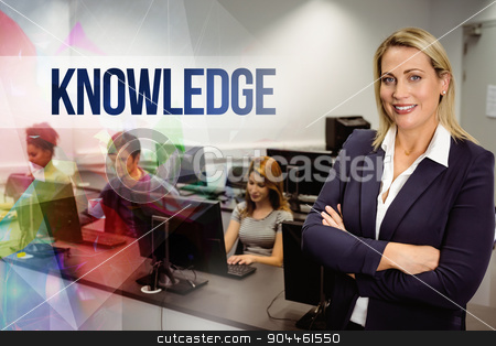 Knowledge against computer teacher smiling at camera with arms c stock photo, The word knowledge against computer teacher smiling at camera with arms crossed  by Wavebreak Media