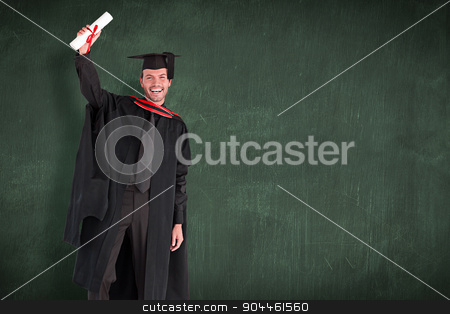 Composite image of smiling handsome boy showing his diploma to t stock photo, Smiling handsome boy showing his diploma to the camera  against green chalkboard by Wavebreak Media