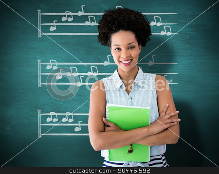 Composite image of portrait of smiling young woman with file stock photo, Portrait of smiling young woman with file against green chalkboard by Wavebreak Media