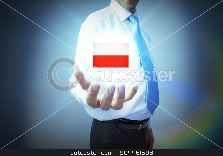 Composite image of businessman holding hand out stock photo, Businessman holding hand out against blue background by Wavebreak Media