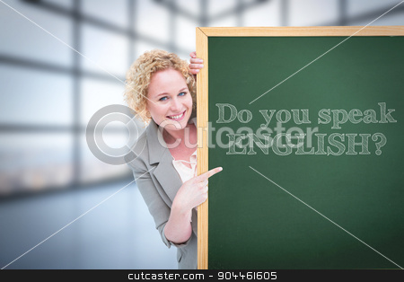 Composite image of woman showing card stock photo, Woman showing card against room with large windows showing city by Wavebreak Media