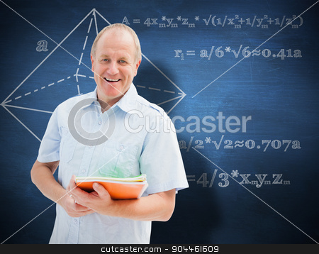 Composite image of mature student holding notebooks stock photo, Mature student holding notebooks against blue chalkboard by Wavebreak Media