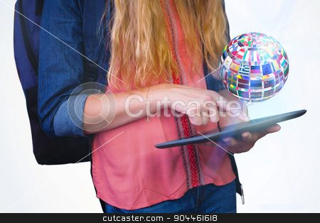 Composite image of student using tablet in library  stock photo, Student using tablet in library  against sphere made of flags by Wavebreak Media