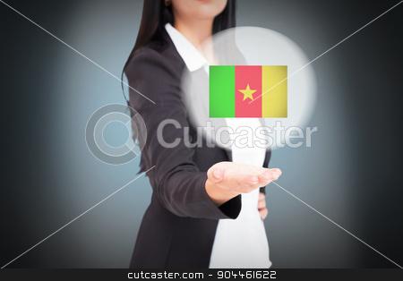 Composite image of pretty businesswoman presenting with hand stock photo, Pretty businesswoman presenting with hand against blue background with vignette by Wavebreak Media
