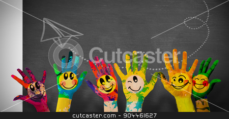 Composite image of hands with colourful smiley faces stock photo, Hands with colourful smiley faces against black background by Wavebreak Media
