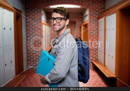 Composite image of student smiling at camera in library stock photo, Student smiling at camera in library against brick walled corridor with tiled flooring in college by Wavebreak Media