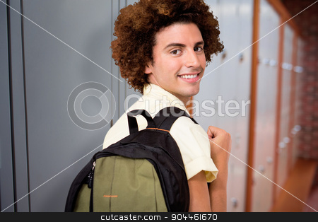 Composite image of casual young man in office corridor stock photo, Casual young man in office corridor against closed lockers in a row at the college by Wavebreak Media