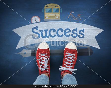Success against blue chalkboard stock photo, The word success and casual shoes against blue chalkboard by Wavebreak Media