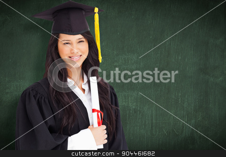 Composite image of a woman standing to the side slightly with he stock photo, A woman standing to the side slightly with her degree and dressed in her graduation robe against green chalkboard by Wavebreak Media