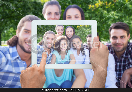 Composite image of hand holding tablet pc stock photo, Hand holding tablet pc against park on sunny day by Wavebreak Media