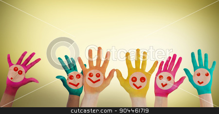 Composite image of hands with colourful smiley faces stock photo, Hands with colourful smiley faces against yellow vignette by Wavebreak Media