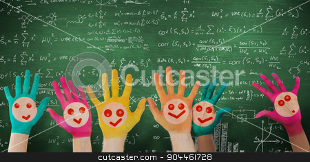 Composite image of hands with colourful smiley faces stock photo, Hands with colourful smiley faces against green chalkboard by Wavebreak Media