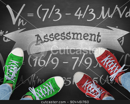 Assessment against black background stock photo, The word assessment and casual shoes against black background by Wavebreak Media