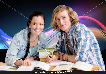 Composite image of college students doing homework in library stock photo, College students doing homework in library against glowing abstract design by Wavebreak Media