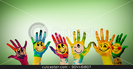 Composite image of hands with colourful smiley faces stock photo, Hands with colourful smiley faces against green vignette by Wavebreak Media