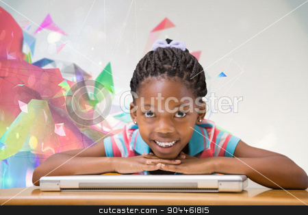 Composite image of smiling pupil sitting at her desk  stock photo, Smiling pupil sitting at her desk  against colourful abstract design by Wavebreak Media