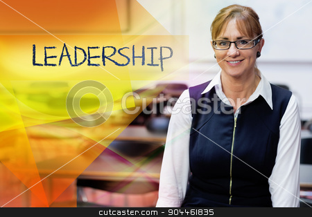Leadership against smiling female teacher in the class room stock photo, The word leadership against smiling female teacher in the class room by Wavebreak Media