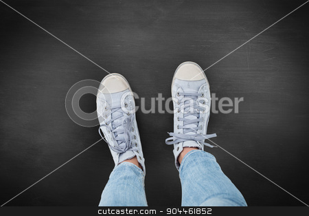 Composite image of woman wearing trainers  stock photo, Woman wearing trainers  against black background by Wavebreak Media