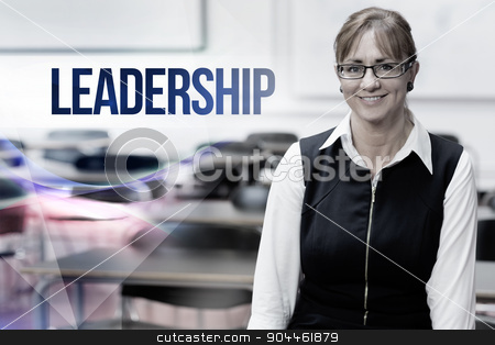 Leadership against smiling female teacher in the class room stock photo, The word leadership against smiling female teacher in the class room by Wavebreak Media