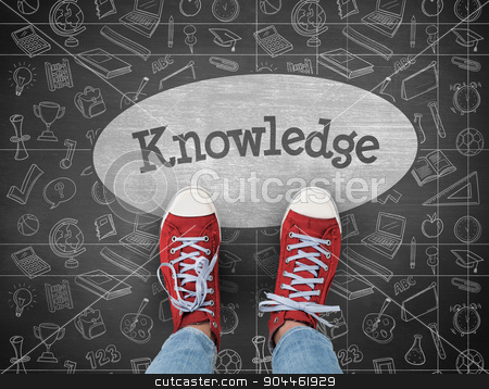 Knowledge against black background stock photo, The word knowledge and casual shoes against black background by Wavebreak Media