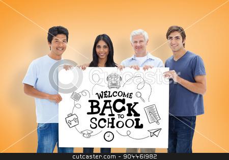 Composite image of people in jeans holding a big sign  stock photo, People in jeans holding a big sign  against orange vignette by Wavebreak Media