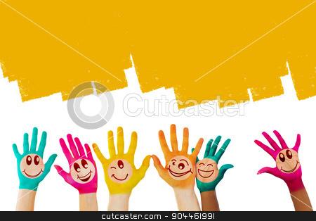 Composite image of hands with colourful smiley faces stock photo, Hands with colourful smiley faces against orange vignette by Wavebreak Media