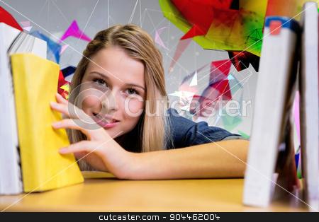 Composite image of pretty student in the library stock photo, Pretty student in the library against angular design by Wavebreak Media