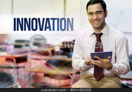 Innovation against teacher with tablet pc in the class room stock photo, The word innovation against teacher with tablet pc in the class room by Wavebreak Media