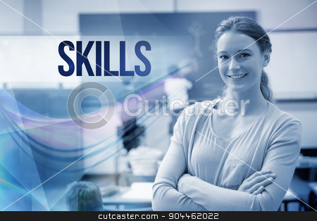 Skills against pretty teacher smiling at camera at back of class stock photo, The word skills against pretty teacher smiling at camera at back of classroom by Wavebreak Media