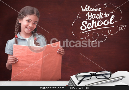 Composite image of cute pupil smiling at camera during class pre stock photo, Cute pupil smiling at camera during class presentation against desk by Wavebreak Media
