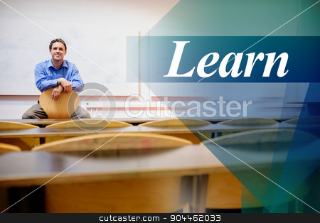 Learn against male teacher sitting on chair in lecture hall stock photo, The word learn against male teacher sitting on chair in lecture hall by Wavebreak Media