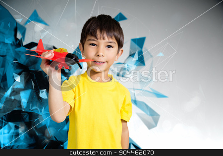 Composite image of cute boy playing with toy airplane stock photo, Cute boy playing with toy airplane against angular design by Wavebreak Media