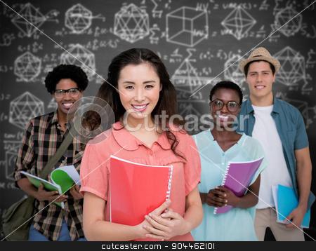 Composite image of stylish students smiling at camera together stock photo, Stylish students smiling at camera together against black background by Wavebreak Media