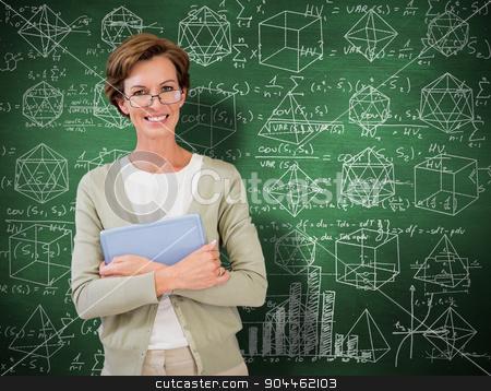 Composite image of teacher holding tablet pc at library stock photo, Teacher holding tablet pc at library against green chalkboard by Wavebreak Media