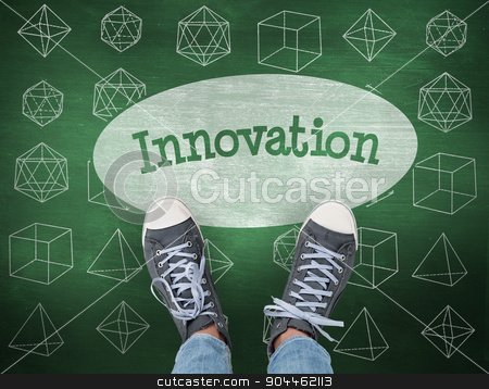Innovation against green chalkboard stock photo, The word innovation and casual shoes against green chalkboard by Wavebreak Media