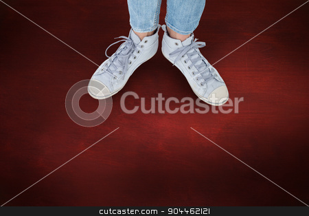 Composite image of woman wearing trainers  stock photo, Woman wearing trainers  against desk by Wavebreak Media