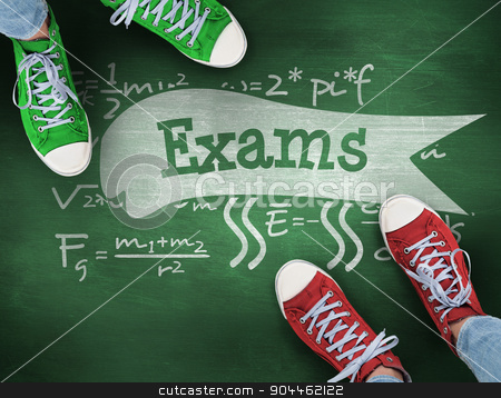 Exams against green chalkboard stock photo, The word exams and casual shoes against green chalkboard by Wavebreak Media