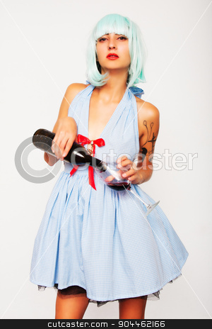 Attractive woman pouring wine in a glass stock photo, Attractive model woman in blue wig and red high heels pouring wine in a glass isolated on white by Jevgeni M