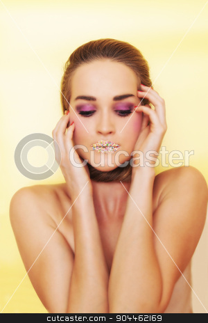 Beautiful model girl posing stock photo, Beautiful model with colourful candies on her lips and bright makeup posing by Jevgeni M