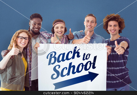 Composite image of fashion students smiling at camera together stock photo, Fashion students smiling at camera together against blue background by Wavebreak Media