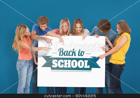 Composite image of a group holding a blank sheet and pointing to stock photo, A group holding a blank sheet and pointing to it against blue background by Wavebreak Media
