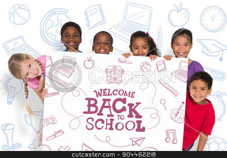 Composite image of elementary pupils showing card stock photo, Elementary pupils showing card against back to school by Wavebreak Media