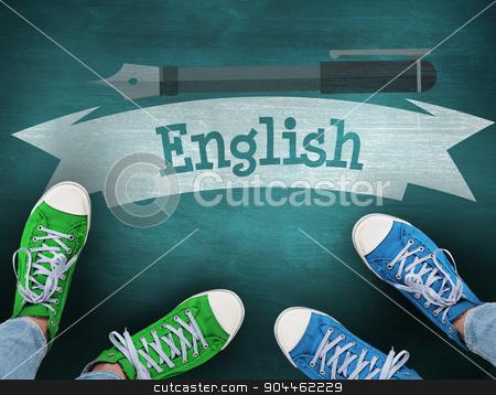 English against green chalkboard stock photo, The word english and casual shoes against green chalkboard by Wavebreak Media