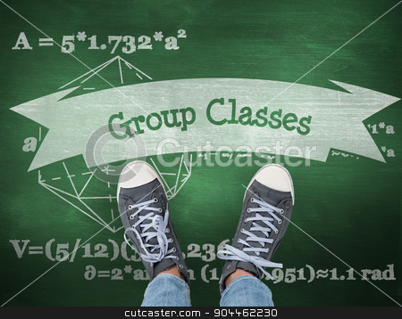 Group classes against green chalkboard stock photo, The word group classes and casual shoes against green chalkboard by Wavebreak Media