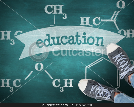 Education against green chalkboard stock photo, The word education and casual shoes against green chalkboard by Wavebreak Media